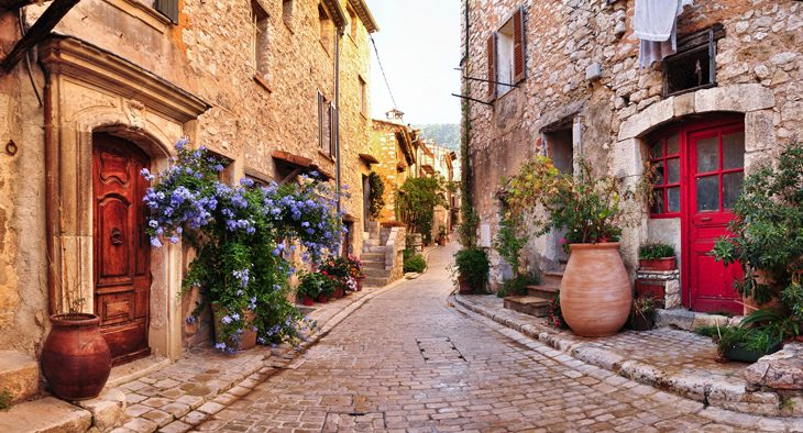 Old French village houses and cobblestone street in Nice