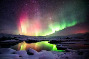 Mixed aurora dancing over the Jokulsarlon lagoo